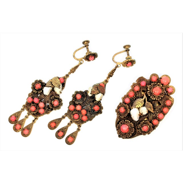 C.1920s Czech gold-plated brass dress clip and screw-back earring set with ornate, raised designs and floral motifs, prong...