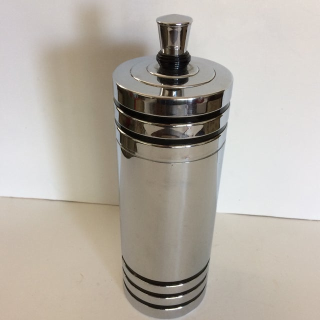This Art Deco Chrome over brass cocktail shaker was originally designed by Harold Reichenback in the early 1930's for...