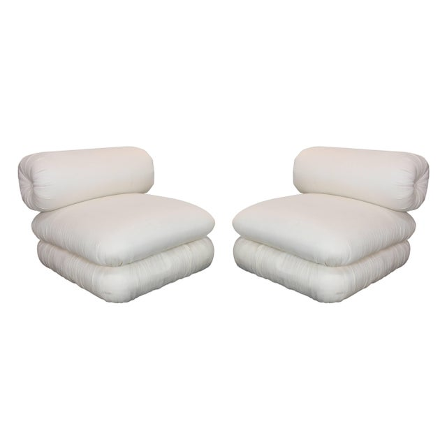 Pair of roll back slipper chairs and ottomans. Upholstery can be cleaned and used as is but new upholstery is recommended....
