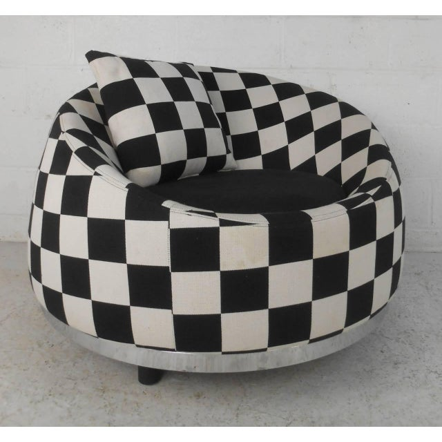 """This stylish contemporary modern club chair features chrome trim, black and white checkered upholstery, a 17"""" seat height,..."""
