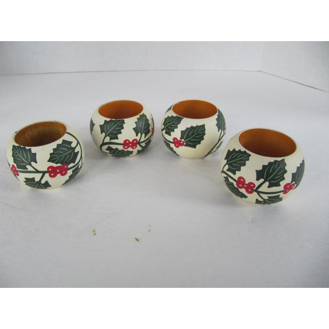 Set of 4 wood napkin rings with holly and leaves. Great for your holiday table.