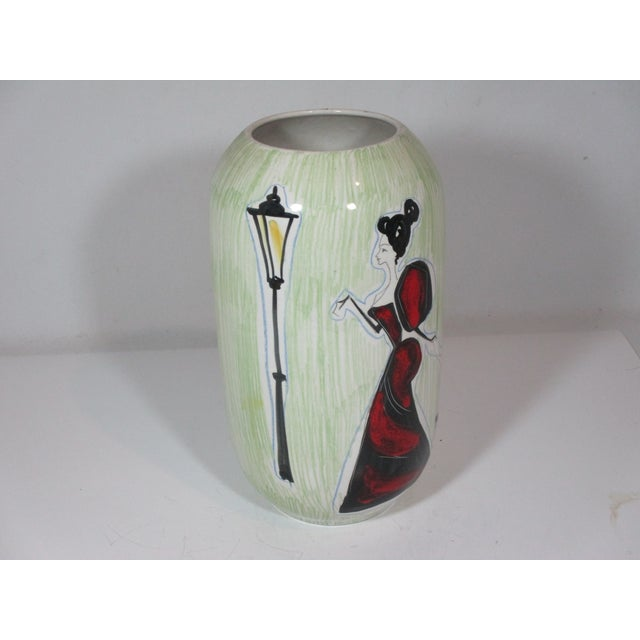 Contemporary hand painted vase made in Italy. The vase is decorated a stylized female figure dressed in a red gown,...