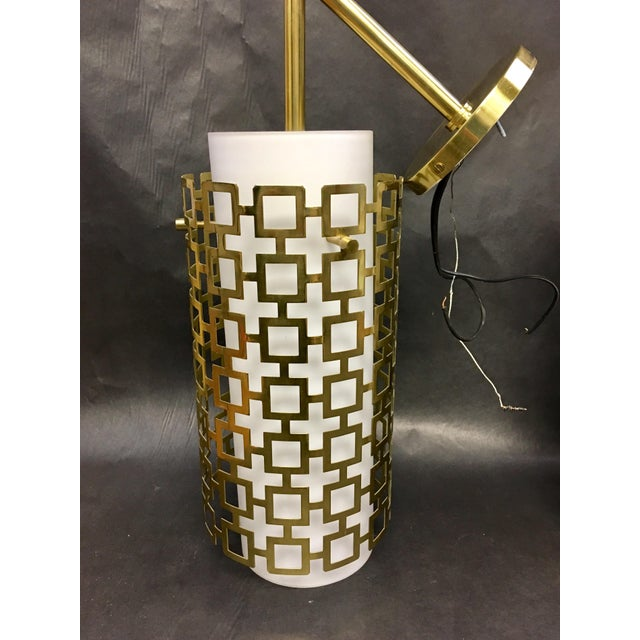 Modern Cylinder Pendant Light With Brass Fretwork. This light has a white frosted glass liner surrounded by brass...