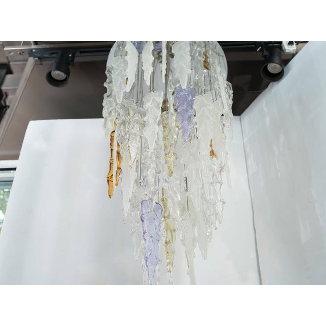 Magnificent and rare chandelier comprised of handblown Murano glass pendants with organic icicle formations. Pendants hang...