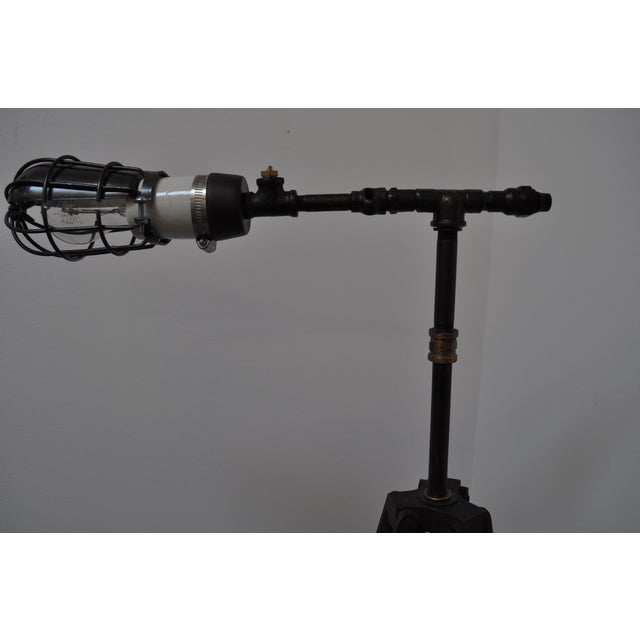 Custom-made floor lamp from a camera tripod found in England, re-wired by Holly Grove Repair & Restoration and given new...