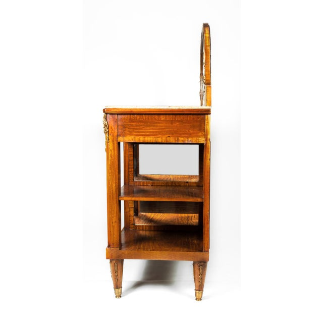 An antique French Louis the XV marble-top sideboard or server, circa 1890. Mahogany with brass and inlay design. All...
