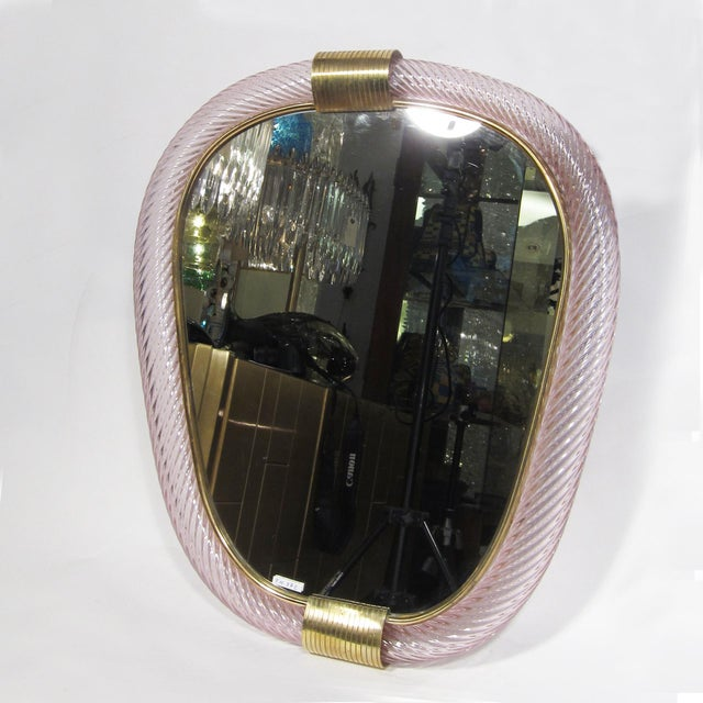 """A rare Archimede Seguso mirror, blown """"Ritorto"""" lilac glass with brass details, shield shaped Made in Italy Conditions :..."""