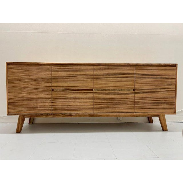 The console provides the mid-century look you crave, but with high-quality modern-day construction. Made with unadorned...