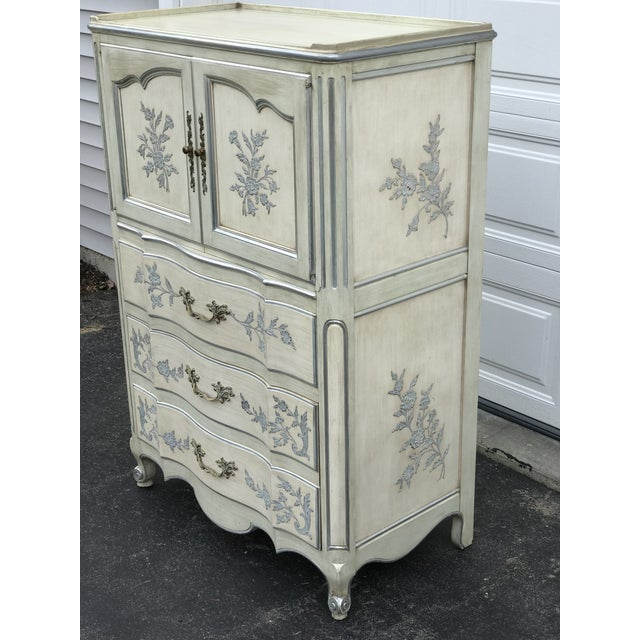 John Widdicomb Hollywood Regency ladies dresser of drawers. Top section opens a cabinet of three drawers. Lower area has...