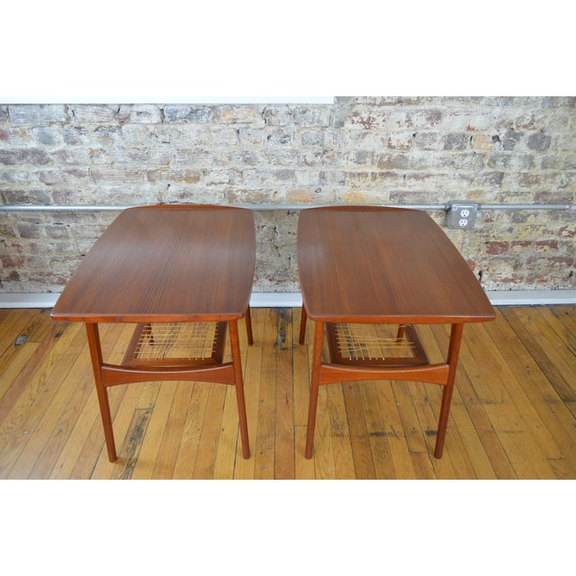 Great looking pair of Danish designed end tables in teak. Tables date to 1964. Tables are relatively clean on the tops and...