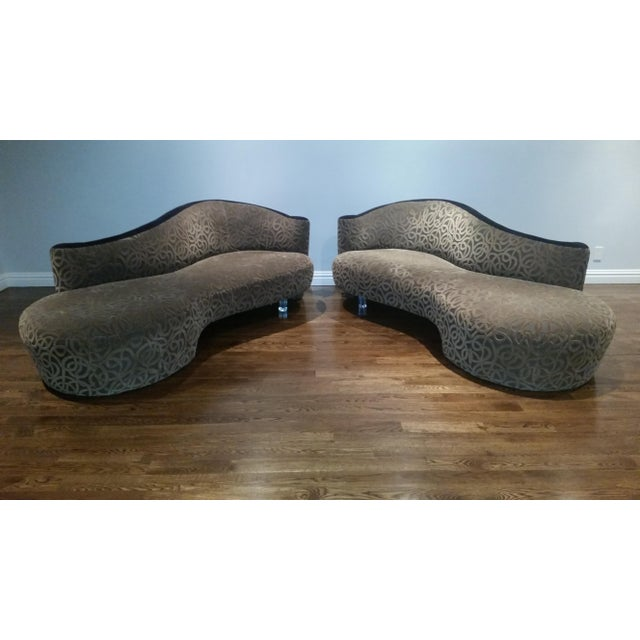 Amazing pair of iconic sofas by Vladimir Kagan for Weiman. Beautiful serpentine/cloud shape, each sofa is raised on a...