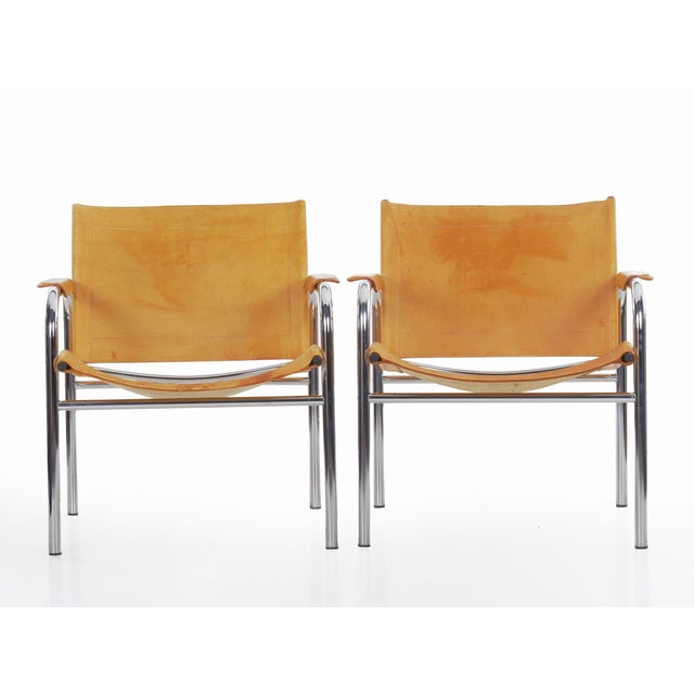 A very cool iconic design by Tord Bjorklund, these simple chromed steel tubular frames are made so interesting with the...