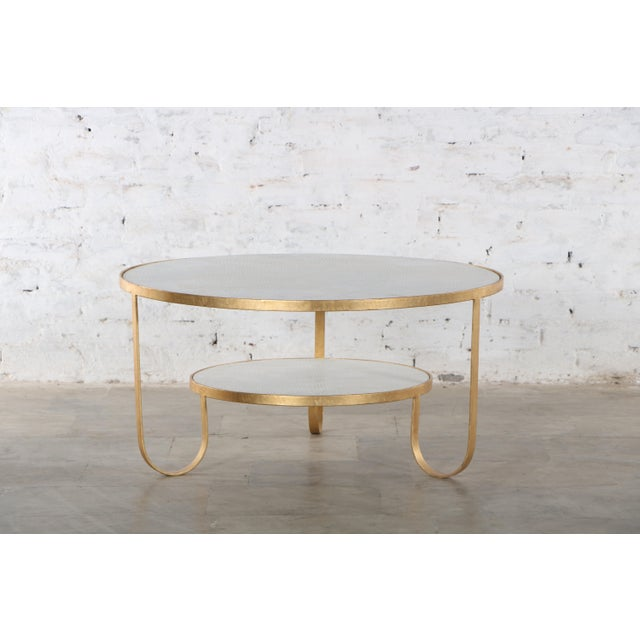 This coffee table has a stunning chiseled white marble top which is complimented by a white marble shelf in the same...