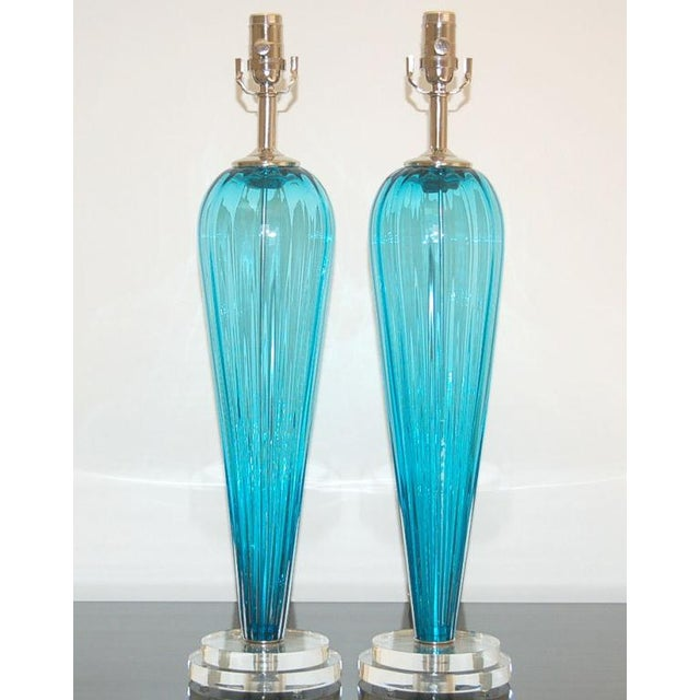 Exclusively blown for Swank Lighting by California artist Joe Cariati, these TEAL BLUE glass table lamps are signed by the...