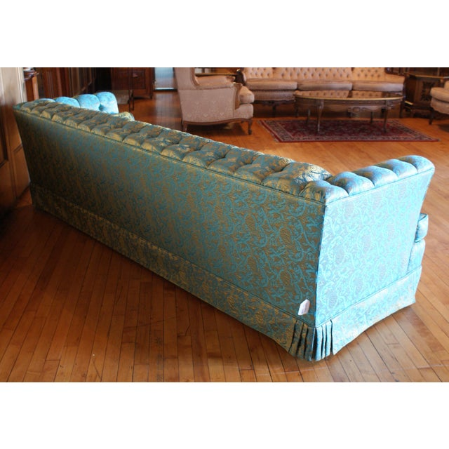 This sofa has a iridescent, blue and gold damask fabric that fluctuates based on the light of the room.