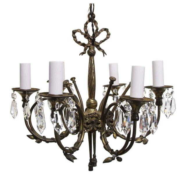 Delicate and petite bronze Spanish six candlestick arm chandelier with pretty leaf and ribbon details and beautiful...