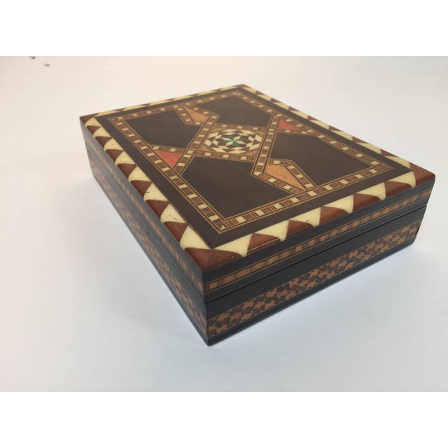 Middle Eastern inlaid with mother-of-pearl, bone, ebony and fruitwood. Great geometric one of a kind Moorish design....