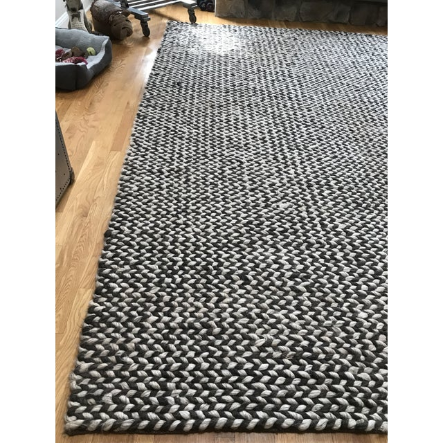RH Description...To create this bold twist on the classic braided rug, master artisans hand weave chunky blended yarns on...