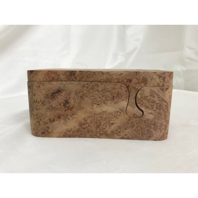Lovely burl wood puzzle box that has two layered trinket dishes fitted inside. Beautiful details and excellent piece for...