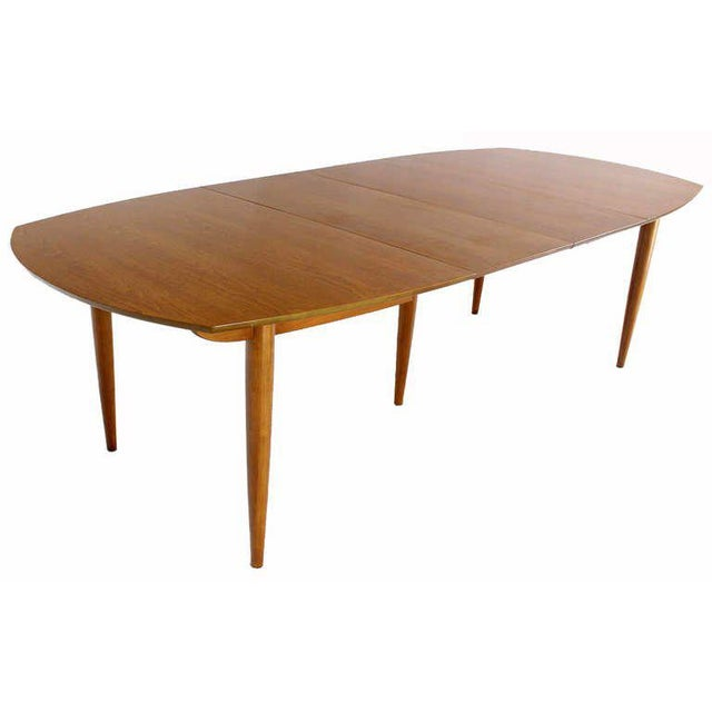 Very nice mid century modern walnut dining table by John Stuart 2 leaves 18 inch each.