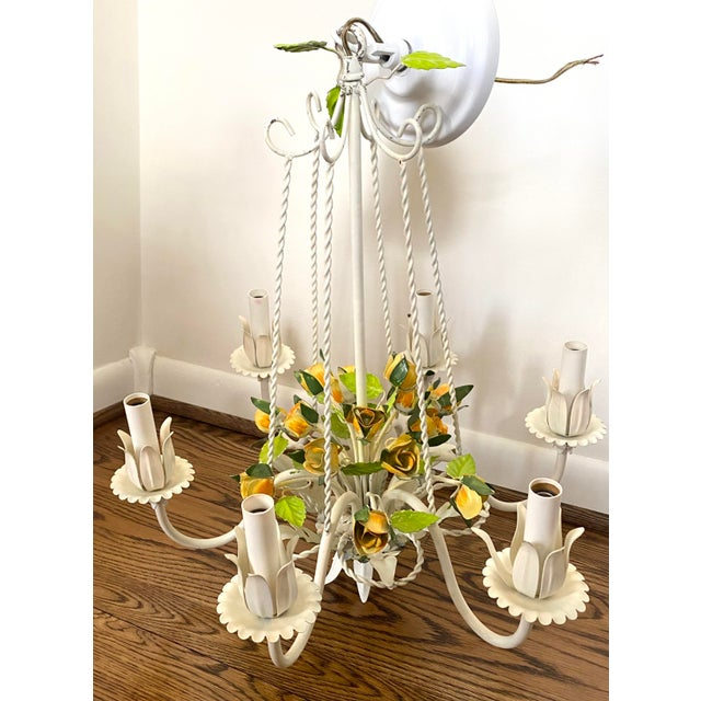 A whimsical, vintage tole chandelier from the mid 20th century featuring charming yellow roses and green leaves. This...