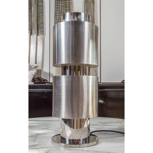 A sleek stainless steel table lamp attributed to Willy Rizzo (1928-2013), Italy, circa 1970. This lamp contains 4 bulbs,...