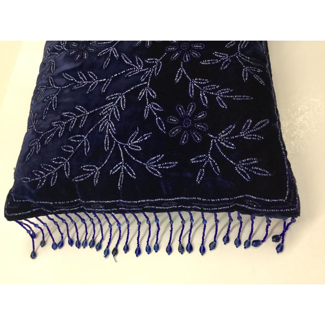 Nice addition to your bedroom or living room in a rich navy blue panne velvet with beaded front and side tassels. One side...