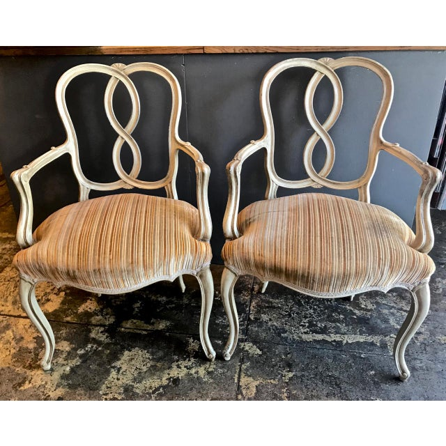 This is a great set of c. 1960-1970s carved Venetian-style painted dining chairs. The beautifully carved arms of the host...