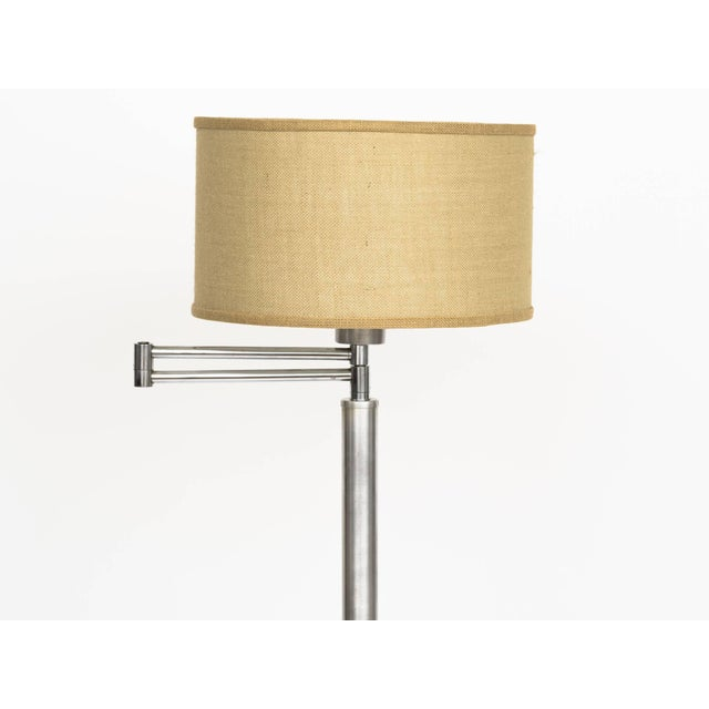 Machine Age brushed aluminium adjustable swing arm floor lamp with milk glass shade diffuser.