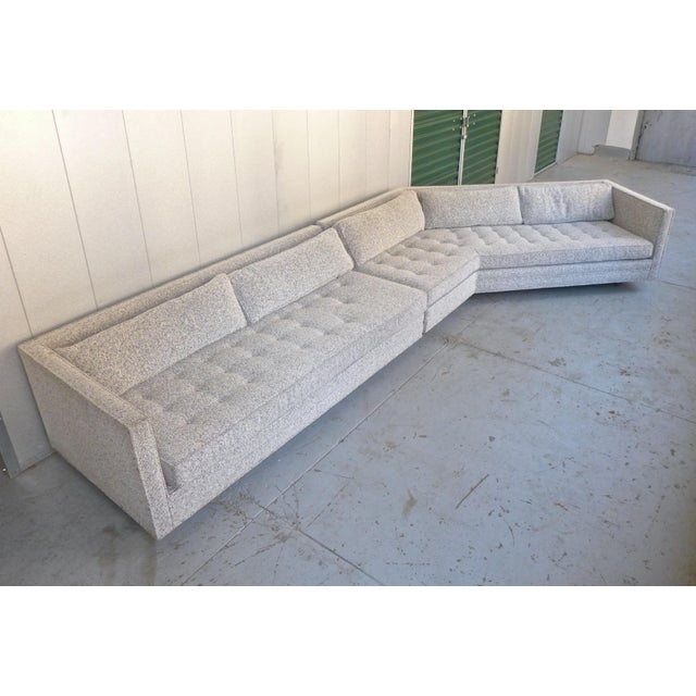 Two-piece sectional sofa with angled section and recessed mahogany cylindrical legs. Designed by Harvey Probber and made...