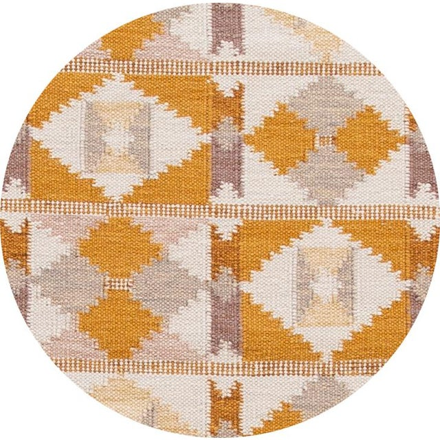 Beautiful contemporary Swedish style runner rug, hand knotted wool with an ivory field, mustard and brown accents in an...