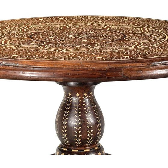 Vintage teak wood and bone inlay round pedestal table. This table is one of a kind with beautiful intricate inlay work...
