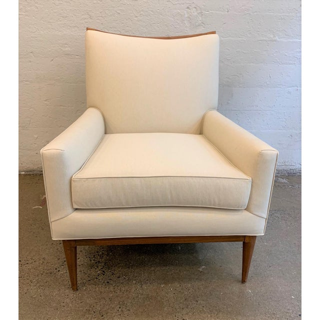 Paul McCobb Lounge Chair. Solid walnut frame and the chair is newly upholstered.