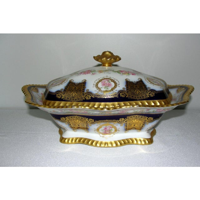 This is a magnificent blue and gold covered casserole dish. A beautiful piece to be displayed on a mantel, china cabinet...
