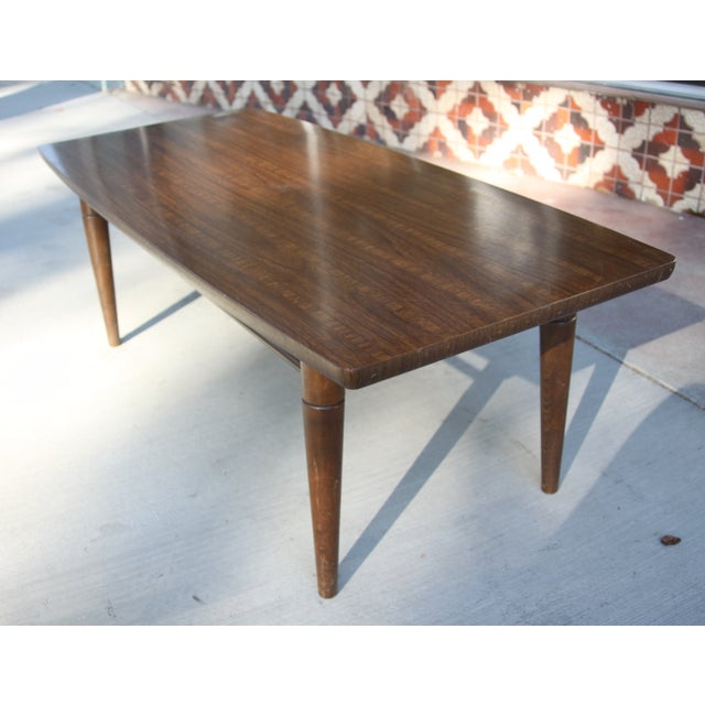 "Baumritter table produced in the the 1950s-1960s—the brand became ""Ethan Allen"" thereafter. Around this table, I can see a..."