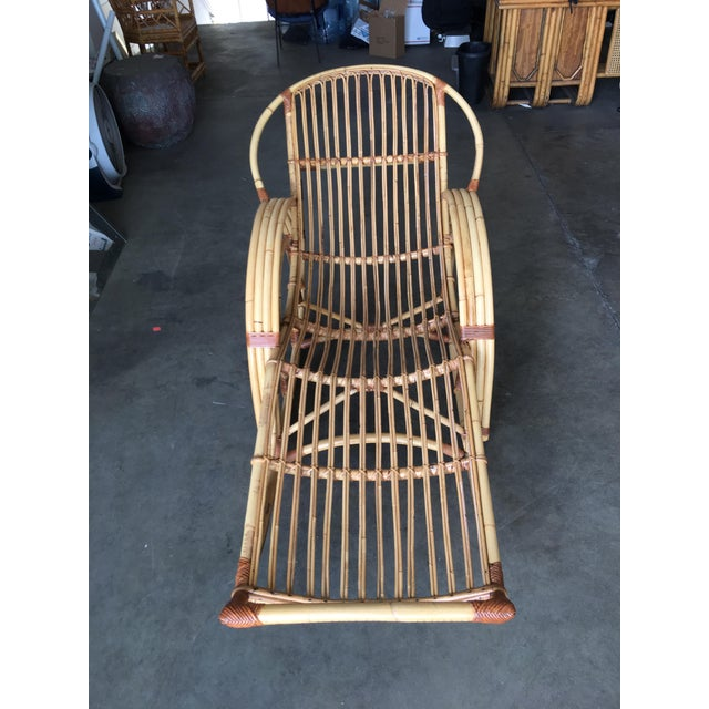"""A rare four Double Arch arm """"Day Dreaming"""" rattan rocking chair with custom made cushions made after purchase. This chair..."""