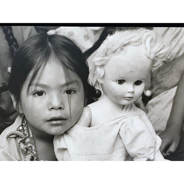 """Illustration Vintage Photograph """"Cultural Confusion -A Navajo Schoolgirl With Her White Doll"""" by Paul S. Conklin For Sale - Image 3 of 6"""