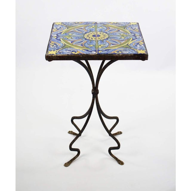 Bring the fiesta straight into your living space with this 1940's Spanish tile and iron side table. The gorgeous tile top...