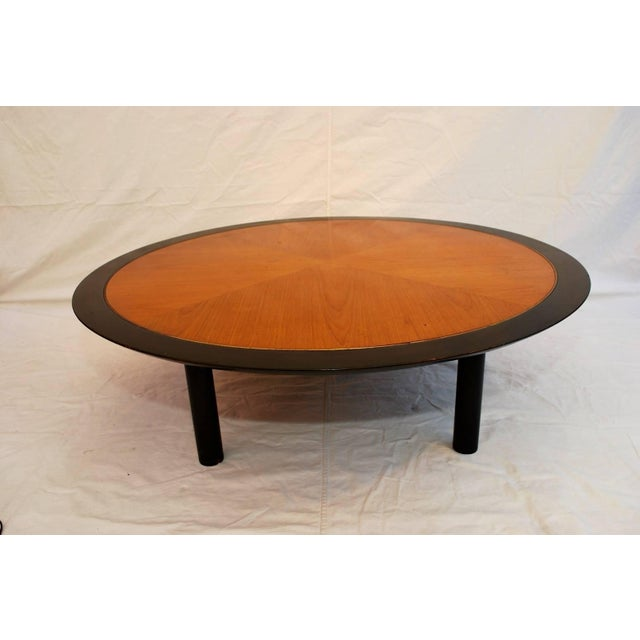 A beautiful coffee table by Baker, it has the ebonized wood with an inlaid brass and a beautiful walnut wood inlaid.