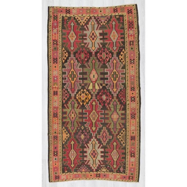 Handwoven decorative Caucasian kilim rug in good condition. Approximately 65-75 years old.