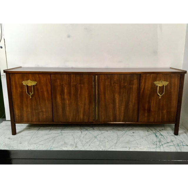 This solid walnut credenza was designed by Bert England for John Widdicomb. The line was called the Orientation Group. The...
