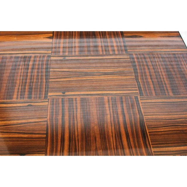 This is a classic French Art Deco center table or game table, circa 1940s. The piece is made of Macassar ebony with a...