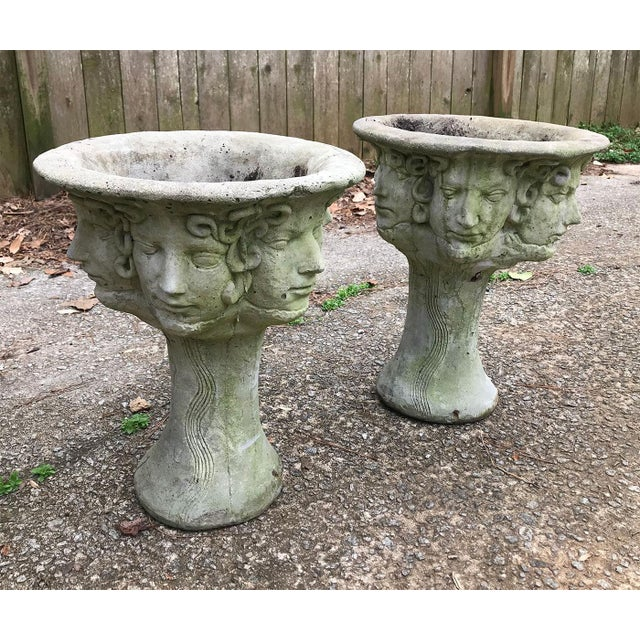 Stunning pair of cast stone (cement) planters, circa 1920s. Made in France. Each features faces and snakes encircling the...