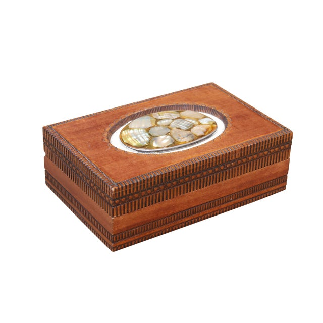 An English carved trinket box made by Cash's of Coventry, a company founded in 1846 that primarily manufactures woven...