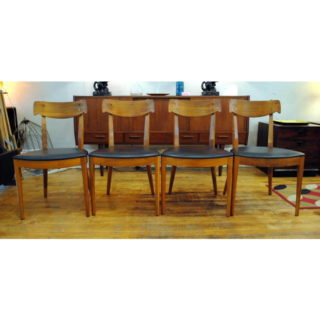 Beautiful and sculpted set of 4 walnut dining chairs with rosewood inlay. Designed by Kipp Stewart and Stewart Macdougall...