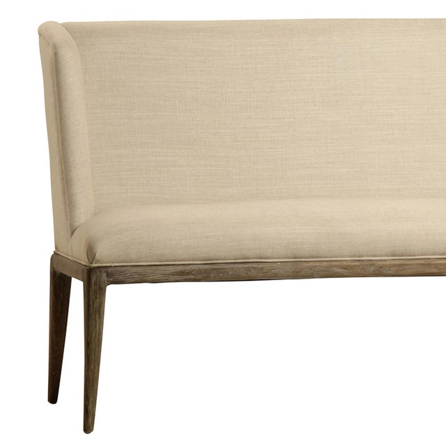 Linen upholstered bench. Oak frame and legs. Linen mix upholstery. Each piece unique with slight variations in color,...