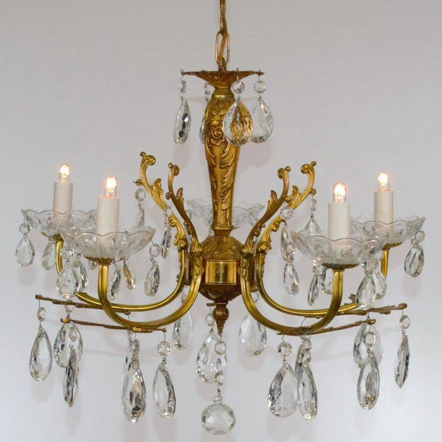 A petit brass chandelier in the Louis XV taste. American, 1920's Cast brass acanthus leaves attached to five reeded...