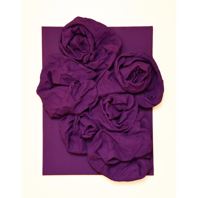 """""""Violet Folds"""" is a mixed media wall sculpture made with burlap and paint on linen. The elegant folds are studiedly built..."""