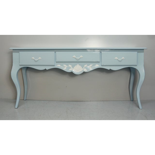 Vintage French carved wood console table refinished in soft blue & white. This beautifully restored console adds a perfect...