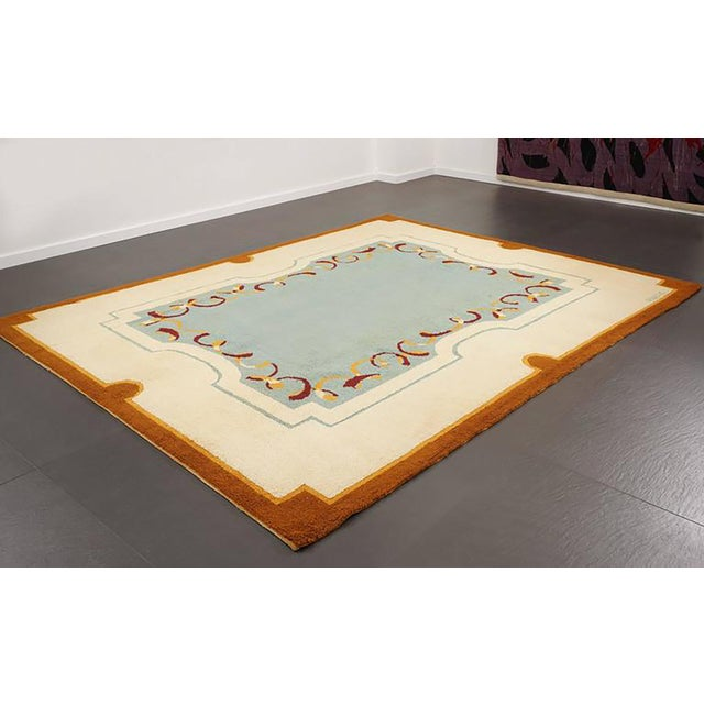 Art Deco style wool rug designed by Robert Debieve, circa 1950 Signature woven on the rug Material: wool Dimensions: 310 x...